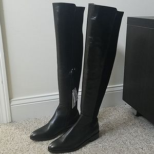 Over the knee black leather and fabric boots